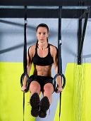 stock photo of dipping  - dip ring woman workout at gym dipping exercise - JPG
