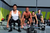 stock photo of kettlebell  - gym group with weight lifting bar workout in exercise - JPG