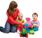 image of babysitter  - Little girl and boy playing together with mother - JPG