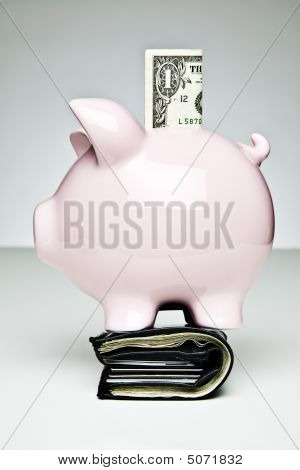 Piggy Bank On A Full Wallet