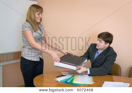 Secretary Gives A Folders To The Chief