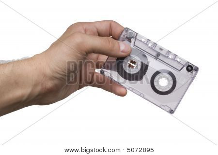 Man Hand With An Old Audio Cassette