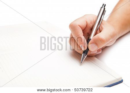 Man hand writing in open book isolated on white