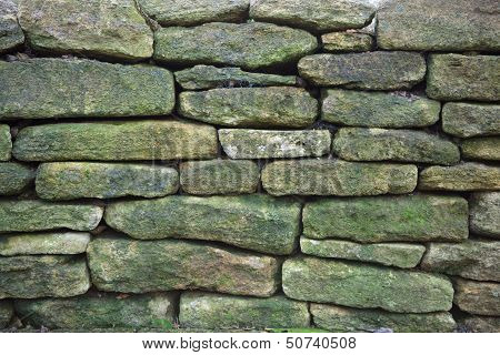 Old weathered rustic stone wall background