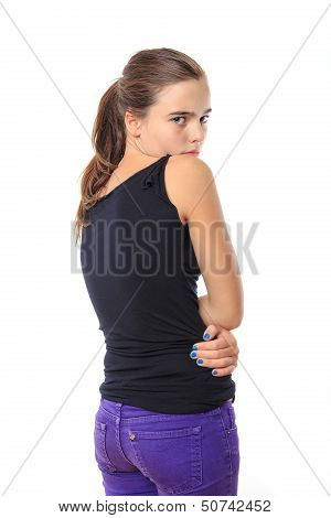 Afraid Teenage Girl Looking Back Over Here Shoulder, Isolated On White