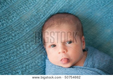 Newborn Baby Boy Sticking Out His Tongue