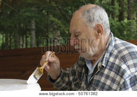 Profile Of Aged Senior Man Painting