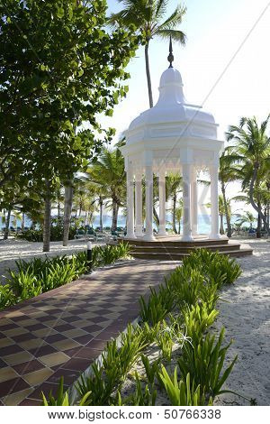 White Gazebo By A Beach