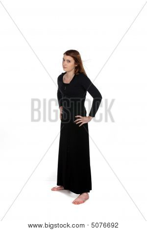 Teenage Girl In Long Black Dress With Annoyed Expression