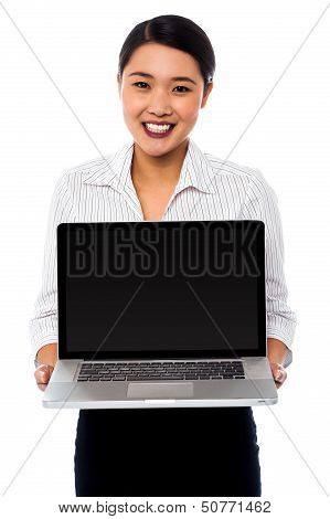 Smiling Saleswoman Presenting Brand New Laptop