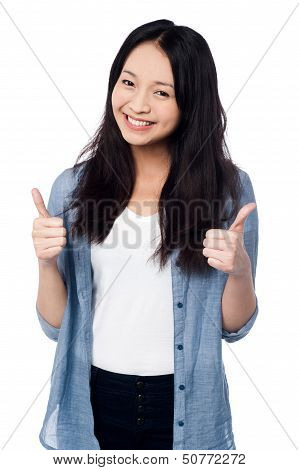 Smiling Young Girl Showing Two Thumbs Up