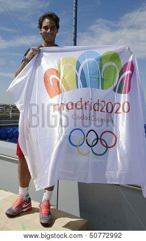 Thirteen  times Grand Slam champion Rafael Nadal holding Madrid 2020 Summer Olympic flag