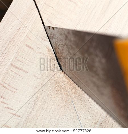 Wooden Plank Is Cut With Hacksaw