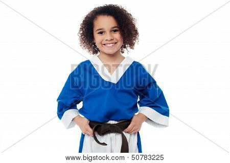 Little Girl Adjusting Her Brown Karate Belt