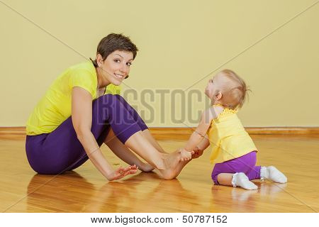 Mother Do Phisical Exercises With Her Daughter At Home