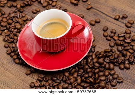 Red Cup Espresso On A Black Brown Table