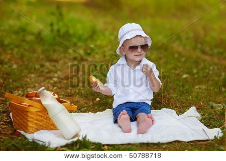 Caucasian Baby Boy Palys In Park