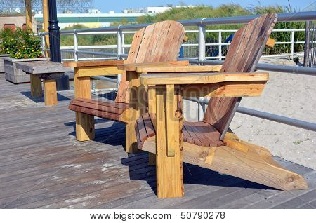 Adirondack Style Chairs On The Boardwalk