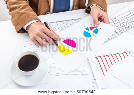 Businessman analysing chart.