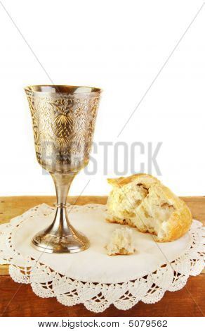 Communion Bread And Wine On White Background