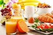 stock photo of fruit bowl  - Breakfast with coffee orange juice croissant egg vegetables and fruits - JPG