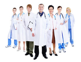 picture of male female  - happy team of successful doctors standing together in hospital gowns - JPG