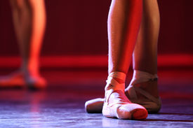 stock photo of ballet dancer  - Ballet dancer legs and pointe shoes on stage  - JPG