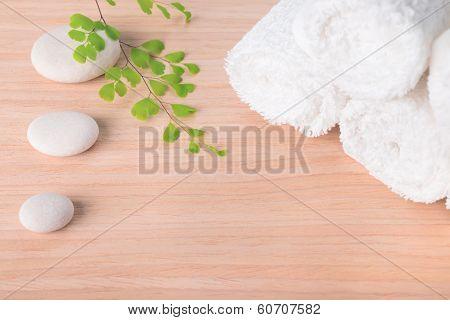 Spa Still Life With Stone, Green  Branch  And White Towel On Wood Background