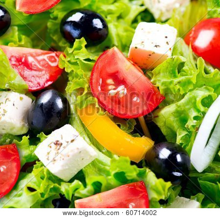 Salad. Greek Salad Background. Mediterranean Salad close up with Feta Cheese, Tomatoes and Olives. Food background