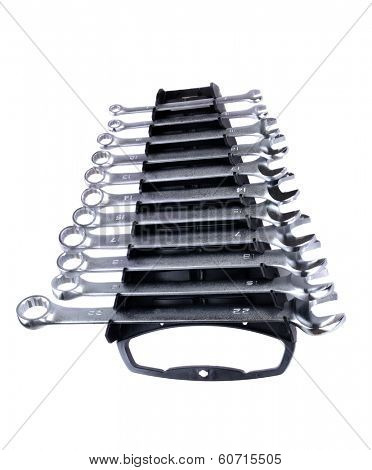 set of open and box metric wrenches in a handy tool carrier isolated on white