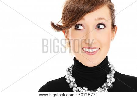 A portrait of a pretty woman glancing at something over white background