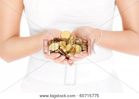 Bride holding in hands gold coins over white background