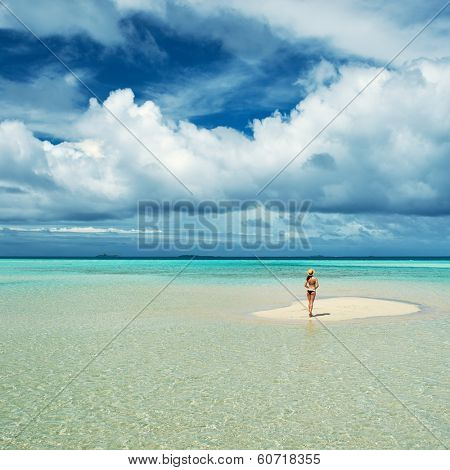 Woman in bikini at tropical beach