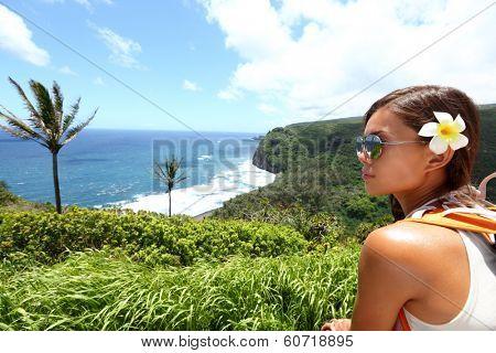 Hawaii Big Island - woman looking at view of beautiful Hawaiian landscape nature beach on Big Island during vacation travel.
