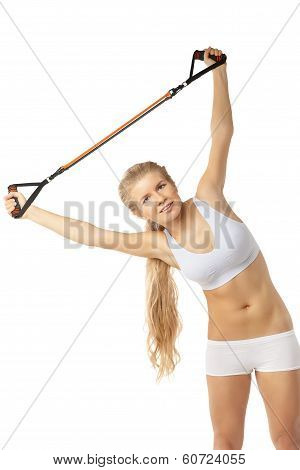 Woman exercising with resistance band on white