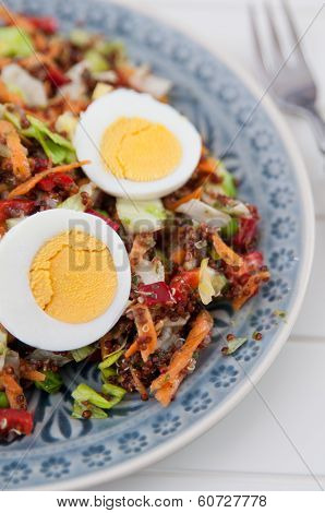 Healthy Quinoa Salad with colorful vegetables and egg