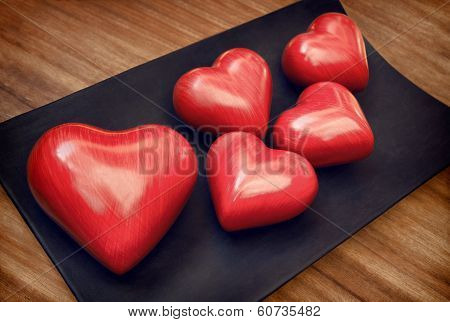 Vintage Red Wooden Valentine Hearts On Brown Woody Table