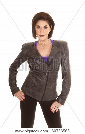 Older Woman Gray Jacket Over Purple Shirt Stand Serious