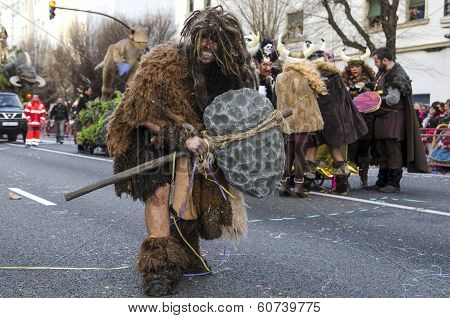 Man dressed Neanderthal in carnival