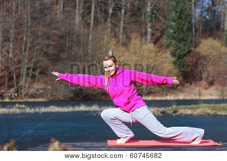 Woman Teenage Girl In Tracksuit Doing Exercise On Pier Outdoor