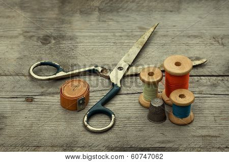 Vintage Background With Sewing Tools.