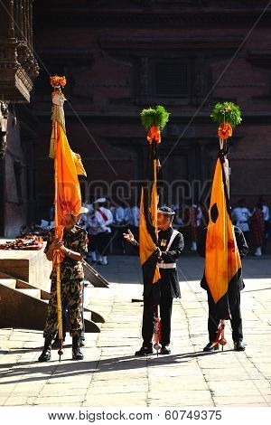 Nepali Soldiers Standing With Flags During A Festivity