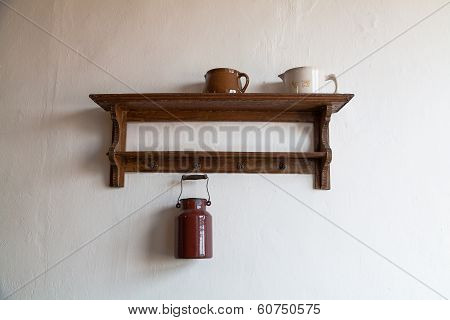 Old Wooden Shelf With Milk Jug