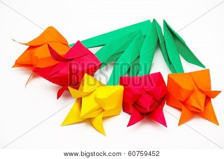 Five Colored Paper Tulips On A White Background