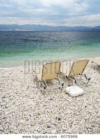 Sunbeds At Beach Of Kassiopi, Corfu, Greece