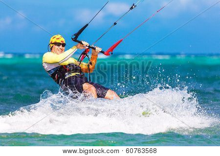 Smiing Kitesurfer On Sea Background