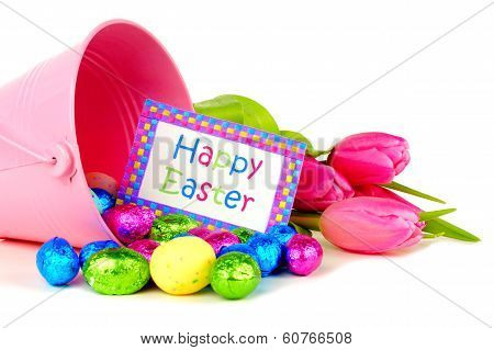 Easter decor and candy over white