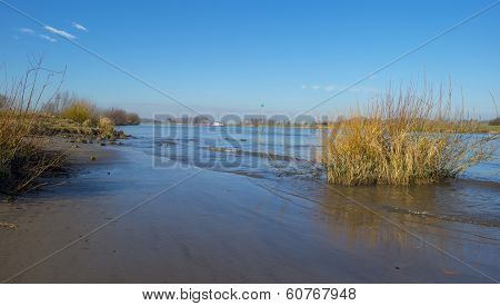 Barge sailing on a sunny river in winter