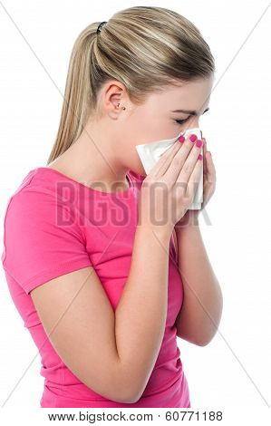 Young Girl Sneezing, Suffering From Cold