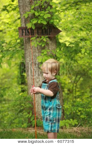 Little boy with a fishing pole